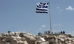 A Greek flug flutters at the top of the Acroplis hill in Athens July 2, 2013.
