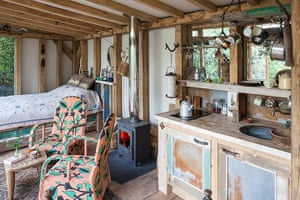 Homes - Bristol House - The bed, kitchen and logon stove in the cabin
