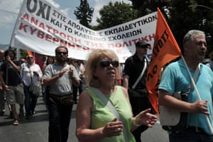 Greek teachers protest outside the ministry of administrative reforms on July 2, 2013, against layoffs and relocations demanded by Greece's creditors.