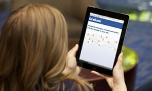 woman using facebook on ipad