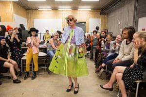 Grayson Perry models a dress by Tinghzu Lau