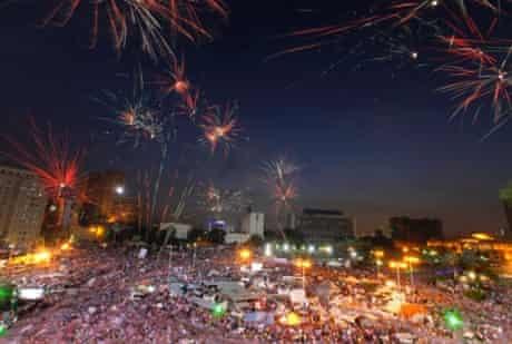 Fireworks burst over opponents of Egypt's Islamist President Mohammed Morsi in Tahrir Square in Cairo, Egypt, Tuesday, July 2, 2013.