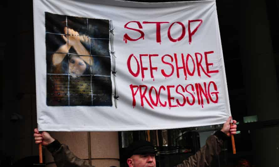 A banner protests offshore processing of asylum seekers in Melbourne on 20 July 2013.