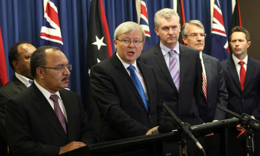 Kevin Rudd and Papua New Guinea's prime minister Peter O'Neill talk to the media after announcing a policy on asylum seekers in Brisbane on July 19, 2013.