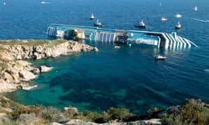The Costa Concordia cruise liner lies on its side off the Italian island of Giglio