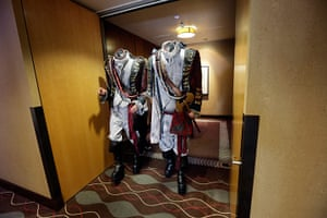 Comic-con: Two men dressed as headless characters get out of a hotel lift