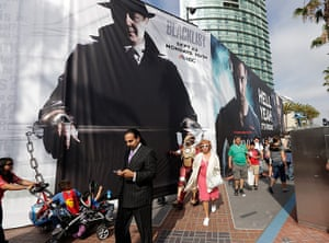 Comic-con: People pass advertisements for movies and television shows