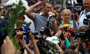 Russian opposition leader Alexei Navalny addresses supporters and media after arriving in Moscow