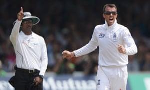 Graeme Swann celebrates the wicket of Phil Hughes.