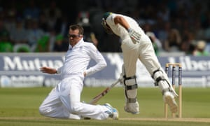 Graeme Swann reacts after a collision with Usman Khawaja.