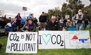Anti-carbon tax protesters known as The Convoy of No Confidence listen to speeches in front of Parliament House in Canberra.