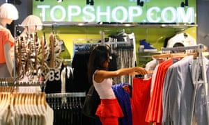 A woman shopping in a Topshop store