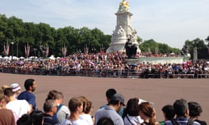 Crowds wait for news of the royal baby on 22 July 2013.