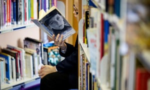 child reading in school library