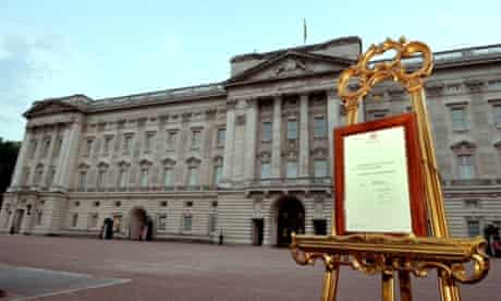 A notice formally announcing the birth of a son to Britain's Prince William and Catherine, Duchess of Cambridge, is placed outside Buckingham Palace.
