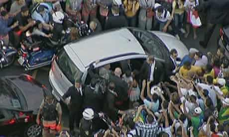 The pope's car is mobbed by well-wishers after taking a wrong turn on the road from the airport.