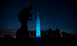 The Peace tower and parliament buildings in Ottawa, Ontario, are illuminated in blue to celebrate the birth of the royal baby