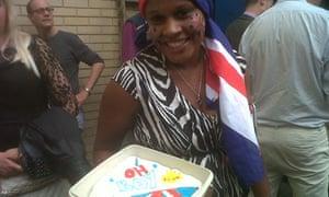 Teba Diatta with her cake celebrating the royal birth.