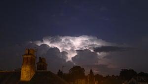 Stormy weather: Lighting illuminates the storm clouds over Tunbridge Wells in Kent