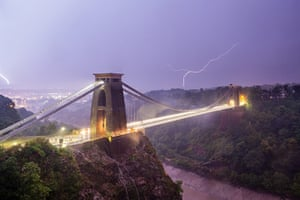 Stormy weather: The sky is filled with lightning behind the iconic Clifton Suspension Bridg