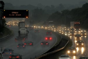 Stormy weather: Rush hour commuters battle the torrential rain on the M42 south of Birmingh