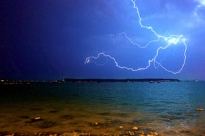 Stormy weather: Lightning flashes across the sky above Poole Harbour in the early hours of