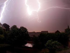 Stormy weather: Lightning flashes across the sky above Portishead, Bristol, in the early ho