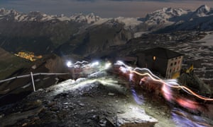 A long exposure shows the headlamps of mountaineers climbing 14,688 foot high Matterhorn above Zermatt, Switzerland.