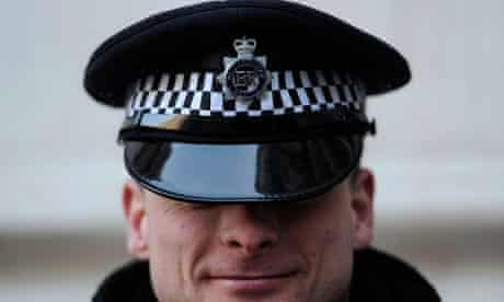 A police officer is pictured in Downing