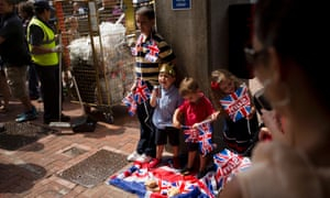 Children have an impromptu picnic wait to see if today's the day they might catch a glimpse of the Duke and Duchess of Cambridge with their new baby at St Mary's Hospital.
