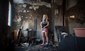 Inna Shevchenko of the feminist protest group Femen, inspects their Paris headquarters which has been damaged by fire. The police are treating the blaze as an accident.