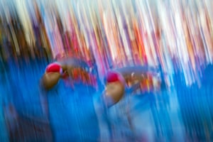Special filters were used for this image of two athletes in action during the men's 3m Synchro Springboard diving final of the 15th FINA Swimming World Championships at Montjuic Municipal Pool in Barcelona, Spain. Photograph: David Ebener/dpa/Corbis