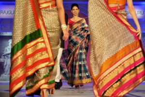 Indian models draped in sarees walk the ramp during a fashion show organised by the Indian ethnic fashion garment house 'Rajguru Rise,' in Bangalore. Photograph: Manjunath Kiran/AFP/Getty Images