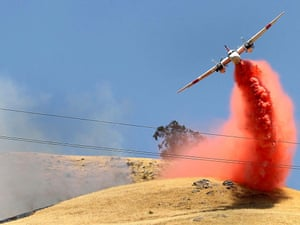 An air tanker comes in low for a fire retardant drop on wildfires in Frazier Park, California, United States. Photograph: ZUMA/Rex Features