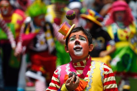 A clown juggles during a parade to inaugurate the 5th Annual Clowns' Convention in Guatemala City, Guatemala. According to the organizers, the convention sees participants coming from Mexico and Central America. Photograph: Jorge Dan Lopez/Reuters
