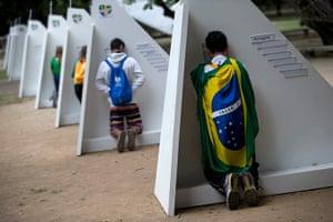 Pope in Brazil: Catholics kneel at portable confessionals set up in Quinta da Boa Vista par