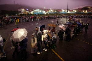 Pope in Brazil: Pilgrims line up as they wait under the rain to enter the Aparecida basilic