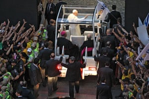 Pope in Brazil: Pope Francis waves from the popemobile on his way to the Guanabara Palace a