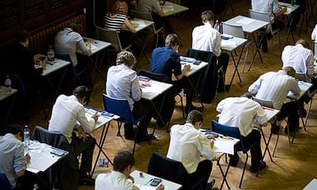Pupils fill an exam hall to take a GCSE exam at Maidstone Grammar school in Maidstone, Kent, U.K.