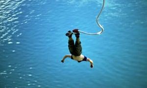Man falling headlong from bungee rope