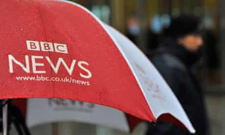A BBC umbrella protects broadcast equipment outside the BBC's New Broadcasting House in London