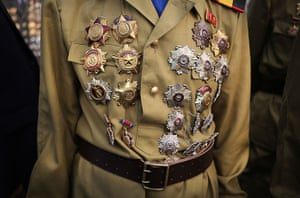 North Korea 60th: Veteran North Korean soldiers arrive in full military dress