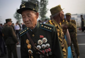 North Korea 60th: Veteran North Korean soldiers arrive in full military dress to pay their re