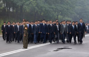 North Korea 60th: A North Korean soldier stands guard as people arrive for the opening ceremo