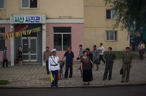 North Korea 60th: Commuters wait at a bus stop in Pyongyang