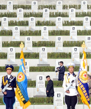 North Korea 60th: North Korean leader Kim Jong -un walks through the cemetery for Korean War