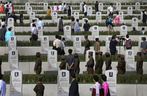 North Korea 60th: North Koreans walk among tombstones and pay their respects,at the cemeterie