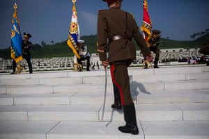 North Korea 60th: North Korean honoru guard soldiers lift their flags at an opening ceremony
