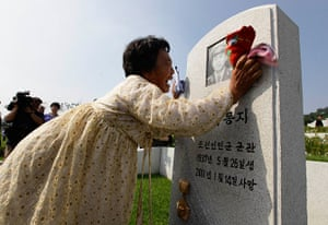 North Korea 60th: A North Korean woman Kim Bu-ok cries as she mourns her father in Pyongyang