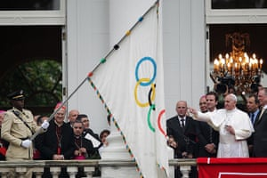 Pope in Brazil: Pope Francis blesses the Olympic flag next to the head of Brazil's Olympic